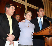 Washington, DC - March 19, 2003 -- United States Representative Vito Fossella (Republican of the 13th District of New York), right, issues a call on the Saudi Government to release documents on terrorist finances at a press conference in the U.S. Capitol on March 19, 2003.  With Rep. Fossella are Joan Molinaro of Staten Island, center, the mother of firefighter Carl Molinaro who died on 9/11, and William Doyle of Staten Island, left, the father of Joey Doyle, a Canter Fitzgerald employee who died on 9/11..Credit: Ron Sachs / CNP.(Restriction: No New York Metro or other Newspapers within a 75 mile radius of New York City)