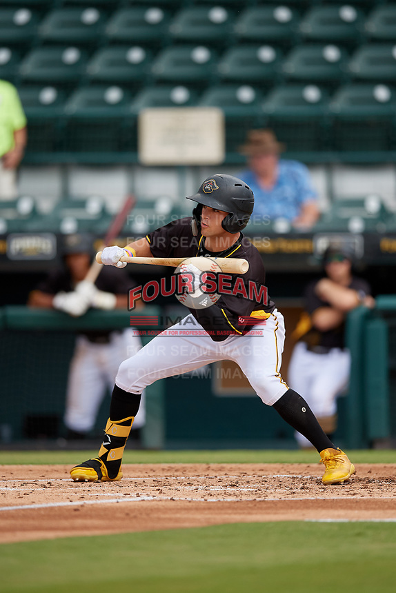 Bradenton Marauders Travis Swaggerty (12) squares to show bunt during a Florida State League game against the Palm Beach Cardinals on May 10, 2019 at LECOM Park in Bradenton, Florida.  Bradenton defeated Palm Beach 5-1.  (Mike Janes/Four Seam Images)