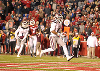 NWA Democrat-Gazette/MICHAEL WOODS • Mississippi State receiver Fred Ross shakes an Arkansas defender to score the go ahead touchdown late in the 4th quarter of Saturday nights game at Razorback Stadium November 21, 2015.