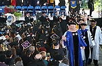 President Chet Burton congratulates graduates following the 45th annual Western Nevada College Commencement ceremony in Carson City, Nev., on Monday, May 23, 2016. A record 556 graduates received 598 degrees.<br />
