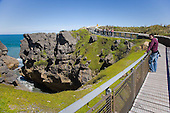 Tourists view the rock formations at Punakaiki, Buller district, West Coast, South Island, New Zealand.
