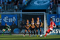 Michel (31) of FC Dallas takes free kick as Brian Carroll (7), Daniel Cruz (44), and Sebastien Le Toux (11) of the Philadelphia Union form a wall. The Philadelphia Union and FC Dallas played to a 2-2 tie during a Major League Soccer (MLS) match at PPL Park in Chester, PA, on June 29, 2013.