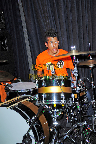 Solomon Radke of Radkey <br /> performing in concert, The Blackeart, Camden, London, England. <br /> 17th October 2013<br /> on stage in concert live gig performance performing music half length orange top drums <br /> CAP/MAR<br /> &copy; Martin Harris/Capital Pictures