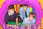 TUNNEL VISION: At the unveiling of the new green flag at St Oliver's NS in Ballylongford on Friday were classmates James O'Connor, Jesse Collins and Dennis Heaphy..