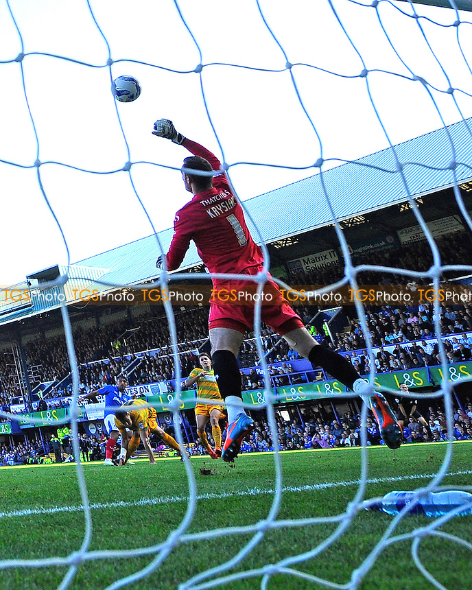 Gary Roberts of Portsmouth left has a shot on goal which Artur Krysiak has coveredfduring Portsmouth vs Yeovil Town, Sky Bet League 2 Football at Fratton Park, Portsmouth, England on 03/10/2015