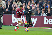 Felipe Anderson pulls up his gloves whilst running during West Ham United vs Arsenal, Premier League Football at The London Stadium on 12th January 2019