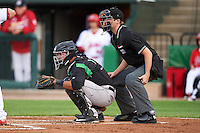 Dayton Dragons catcher Jose Duarte (16) and umpire Ryan Wilhelms during a game against the Peoria Chiefs on May 6, 2016 at Dozer Park in Peoria, Illinois.  Peoria defeated Dayton 5-0.  (Mike Janes/Four Seam Images)