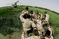 Soldiers from the Worcester and Sherwood Foresters regiment medivac an injuried soldier out of the Green Zone after he got shot by the Taliban during an ambush inside the Green Zone in Helmand Provence, Southern Afghanistan, PRESS ASSOCIATION Photo. Picture date:Tuesday 14th August   , 2007. Photo credit should read: Andrew Parsons/PA.