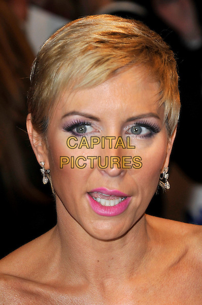 HEATHER MILLS .The 15th National Television Awards held at the O2 Arena, London, England..January 20th, 2010.NTA NTAs headshot portrait mouth open short cropped hair pink lipstick .CAP/PL.©Phil Loftus/Capital Pictures.