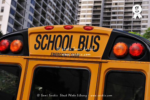 School bus emergency door and buildings (Licence this image exclusively with Getty: http://www.gettyimages.com/detail/84869028 )