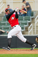 Juan Silverio #18 of the Kannapolis Intimidators follows through on his swing against the West Virginia Power at Fieldcrest Cannon Stadium on April 21, 2011 in Kannapolis, North Carolina.   Photo by Brian Westerholt / Four Seam Images