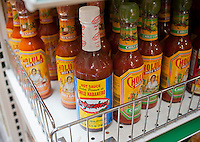 A selection of Hispanic hot sauces are seen in a grocery store in the Lower East Side neighborhood of New York on Saturday, May 26, 2012.  (© Richard B. Levine)