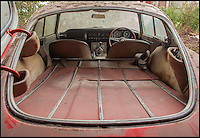 BNPS.co.uk (01202 558833)<br /> Pic: H&amp;HClassics/BNPS<br /> <br /> In need of some TLC...<br /> <br /> It may look ready for the scrapheap, but this E-type Jaguar which has been left to rust for 40 years could fetch up to &pound;150,000 after restoration. <br /> <br /> The classic model, built in 1965, was purchased by its last owner in 1970 as a gift for his wife. <br /> <br /> And the Jaguar has remained in the garage, completely unused, ever since after the owner decided he couldn't bear to part with it.<br /> <br /> It is being sold following his death with a &pound;45,000 estimate by H&amp;H Classics at the  Imperial War Museum in Duxford, Cambs, on October 12.