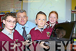 Knockaclarig NS Principal Tomas Roche and his pupils Michael Broderick, Conor Daly and Patricia Murphy who have been selected in a European IT education trial