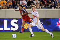 Javier Martina (33) of Toronto FC crosses the ball in front of Tim Ream (5) of the New York Red Bulls. The New York Red Bulls defeated Toronto FC 5-0 during a Major League Soccer (MLS) match at Red Bull Arena in Harrison, NJ, on July 06, 2011.
