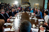 United States President Barack Obama, center right, holds a cabinet meeting at the White House in Washington, D.C., U.S., on Tuesday, July 1, 2014. Obama said yesterday he'll go it alone on changing U.S. immigration rules because House Republicans won't act.<br /> Credit: Andrew Harrer / Pool via CNP