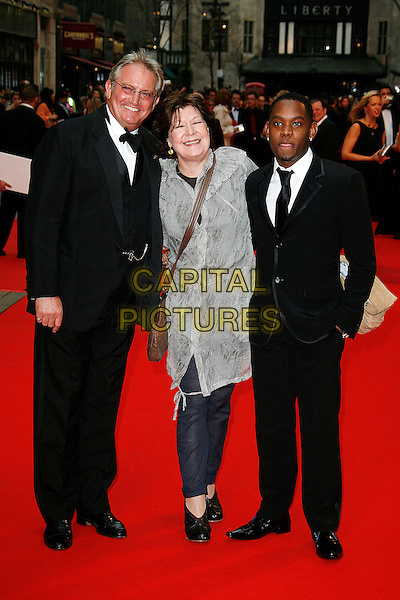 GRAHAM COLE, ROBERTA TAYLOR & MICAH BALFOUR.Red Carpet Arrivals for the British Academy Television Awards 2008, held at the London Palladium, London, England, April 20th 2008..BAFTA BAFTA's full length black suit grey gray sheer top shirt tie .CAP/DAR.©Darwin/Capital Pictures