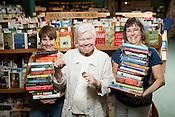 Nancy Olson, Owner of Quail Ridge Books, with NAKE TK and NAME TK, Raleigh, NC, July 13, 2012.