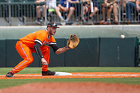 Oklahoma State Cowboys first baseman Tanner Krietemeier #16 records a putout at first base during the NCAA baseball game against the Texas Longhorns on April 26, 2014 at UFCU Disch–Falk Field in Austin, Texas. The Cowboys defeated the Longhorns 2-1. (Andrew Woolley/Four Seam Images)