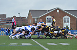 University of Buffalo takes on Georgia Tech in a scrum during a Rugby match.