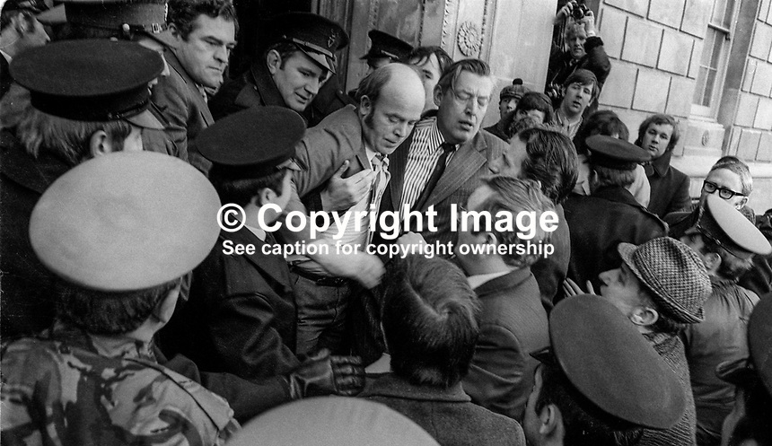 Police eject Democratic Unionist Party leader Ian Paisley and fellow assemblyman, James Craig, from Parliament Buildings, Stormont, N Ireland. Altogether 18 loyalist politicians were ejected by police for disrupting Assembly proceedings. 22nd January 1974. 197401220035e<br />