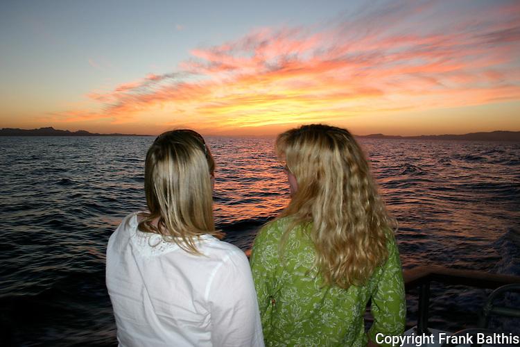 Women watching sunset in Gulf of California