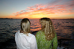 Women watching sunset in Gulf of California
