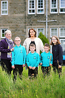 Alfie, Erin McGeough from Amazon (TOP) with L-R deputy head teacher Lisa James Smith, Alfie, twins Lewis and Leon and Jessica,