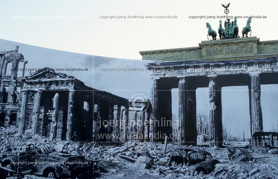GERMANY, Berlin, Brandenburg Gate with sculpture Quadriga, on top the roman goddess Victoria is riding a horse-powered wagon bringing peace to the town, built 1789-1793, outdoor exhibition with photos from world war II
