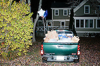 Food donations lay in the back of a pickup while Republican presidential candidate and former Florida governor Jeb Bush speaks to a crowd in the barn of Dr. and Mrs. James Betti in Rye, New Hampshire, for former Massachusetts senator Scott Brown's No B.S. BBQ series.