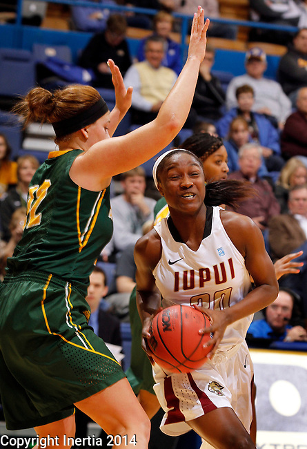 SIOUX FALLS, SD - MARCH 8:  Akilah Sims #30 of IUPUI drives past Holly Johnson #12 of North Dakota State during their quarterfinal game at the 2014 Summit League Basketball Championships at the Sioux Falls Arena.  (Photo by Dick Carlson/Inertia)