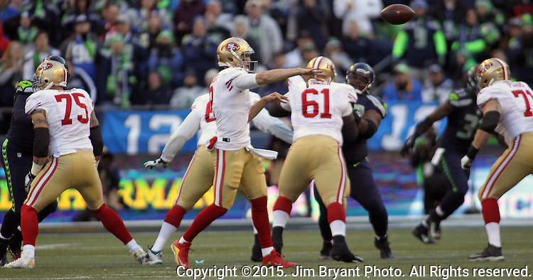 San Francisco 49ers quarterback Blaine Gabbert (10) passes against the Seattle Seahawks at CenturyLink Field in Seattle, Washington on November 22, 2015.  The Seahawks beat the 49ers 29-13.   ©2015. Jim Bryant Photo. All RIghts Reserved.
