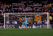9th January 2018, Mestalla Stadium, Valencia, Spain; Copa del Rey football, round of 16, second leg, Valencia versus Las Palmas; Jaume, goalkeeper for Valencia CF waits to clear the ball while supporters show Valencia CF scarves in the stands