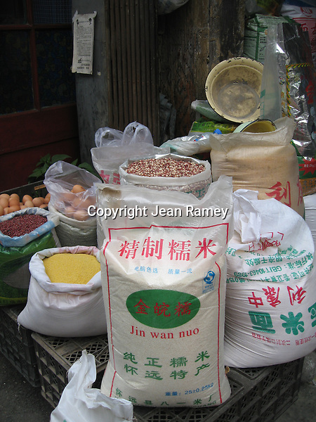 Rice bags and store in hutong, Beijing