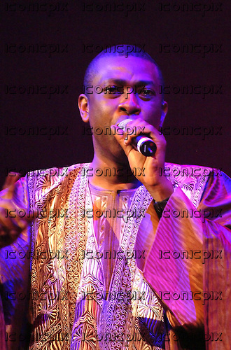 Youssou n'Dour - performing live at the Barbican  Hall, London UK - 20 Oct 2004.  Photo credit: George Chin/IconicPIx