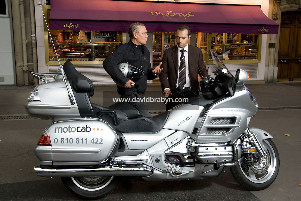 Motocab driver George Meunier (L) and Japauto Honda dealer Director Jose Alves talk in front of Motocab Honda Goldwing 1800 in Paris, France, 21 August 2008.