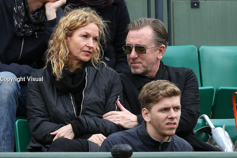 Nikki Butler and Tim Roth watching tennis at Roland Garros tennis open 2016. Paris - may 23. 2016.