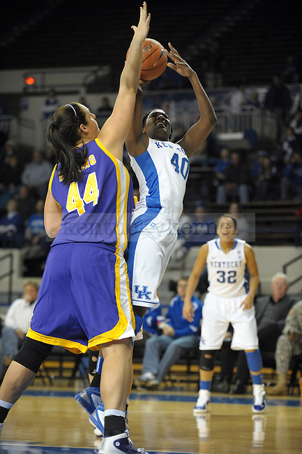 UK's Brittany Henderson shoots over Brittany Darling during the University of Kentucky Women's basketball game against Tennessee Tech at Memorial Coliseum in Lexington, Ky., on 12/7/10. Uk led at half 39-31. Photo by Mike Weaver | Staff