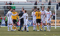 Notts County manager Mark Cooper congratulates his players at full time of the Sky Bet League 2 match between Newport County and Notts County at Rodney Parade, Newport, Wales on 30 April 2016. Photo by Mark  Hawkins / PRiME Media Images.