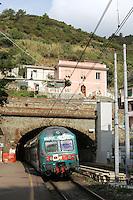 Un treno in transito alla stazione di Riomaggiore, uno dei borghi delle Cinque Terre.<br /> A train passes through the station of Riomaggiore at the Cinque Terre.<br /> UPDATE IMAGES PRESS/Riccardo De Luca