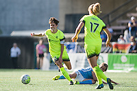 Seattle, WA - Sunday, April 17, 2016: Seattle Reign FC midfielder Keelin Winters (11) pushes past Sky Blue FC midfielder Kelly Conheeney (24). Sky Blue FC defeated the Seattle Reign FC 2-1 during a National Women's Soccer League (NWSL) match at Memorial Stadium.