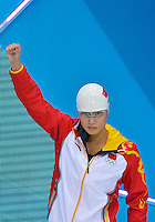 July 28, 2012: YING LU of China waves as she is introduced at the Aquatics Center on day one of 2012 Olympic Games in London, United Kingdom.
