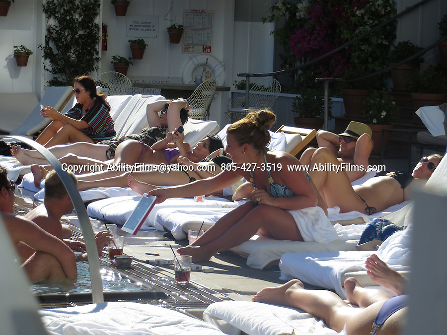 June 29th 2012  Friday      <br /> <br /> Wayne Rooney at the Mondrion Hotel Pool in swimsuit shirtless in Los Angeles swimming <br /> With Coleen McLoughlin wearing a blue bikini <br /> <br /> <br /> AbilityFilms@yahoo.com<br /> 805-427-3519<br /> www.AbilityFilms.com