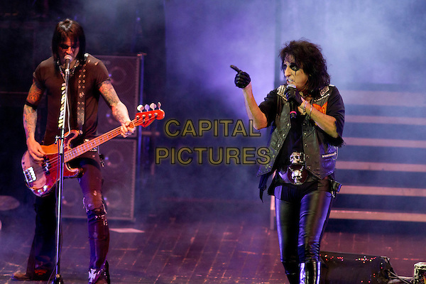 Alice Cooper.Theatre of Death Tour, Crocus City Hall, Moscow, Russia..November 19th, 2011.stage concert live gig performance performing in on full length black jacket  top leather trousers singing guitar gloves pointing 3/4 half.CAP/PER/SB.©SB/PersonaStars/CapitalPictures