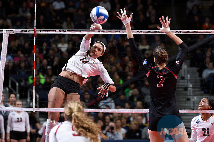 COLUMBUS, OH - DECEMBER 17:  Morgan Johnson (12) of the University of Texas tries to make a kill against Stanford University during the Division I Women's Volleyball Championship held at Nationwide Arena on December 17, 2016 in Columbus, Ohio.  Stanford defeated Texas 3-1 to win the national title. (Photo by Jamie Schwaberow/NCAA Photos via Getty Images)