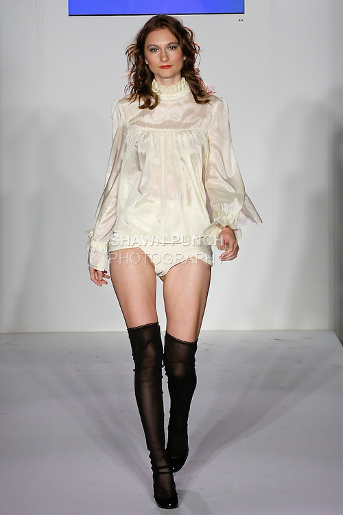 Model walks runway in an outfit by Amelia Boland from the Amelia Boland Spring Summer 2012 collection, at Nolch Fashion Week: New York 2011.