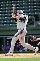 First baseman Jack Havey (26) of the Northwestern Wildcats hits in a game against the Furman University Paladins on Saturday, February 16, 2013, at Fluor Field in Greenville, South Carolina. The game was cancelled in the fifth inning due to snow. (Tom Priddy/Four Seam Images)
