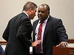 Lobbyist Rocky Finseth, left, talks with Nevada Assemblyman Jason Frierson, D-Las Vegas, at the Legislative Building Carson City, Nev., on Tuesday, May 7, 2013..Photo by Cathleen Allison