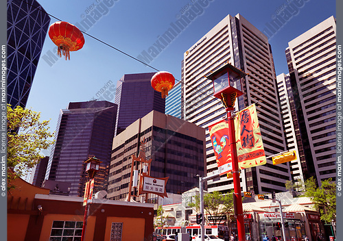 Calgary's Chinatown with it's colorful red Chinese lanterns and oriental decor. Calgary city downtown buildings in the background. Calgary, Alberta, Canada 2017.
