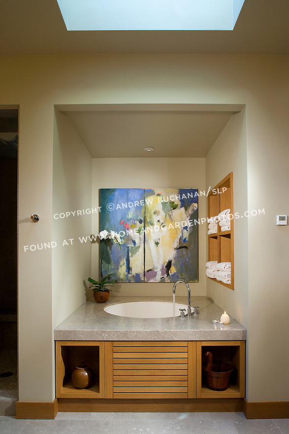 Water fills a Japanese soaking tub in this Pacific Northwest master bathroom. this image is available through an alternate architectural stock image agency, Collinstock located here: http://www.collinstock.com